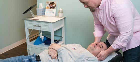 Chiropractor West Hartford CT Dr. Mitchell Graham Adjusting Patient